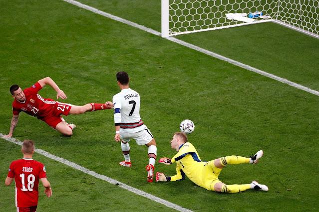 Portugal legend Cristiano Ronaldo scoring against hungary