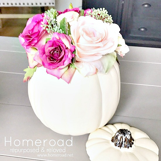 Faux pumpkin centerpiece with faux flowers