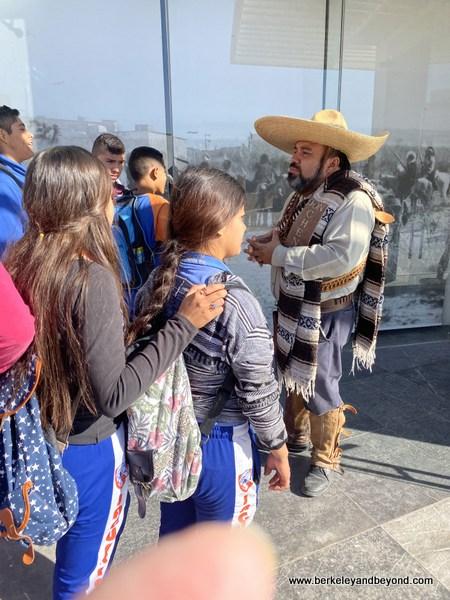 teacher addresses his students outside Museo de la Revolucion en la Frontera in Juarez, Mexico