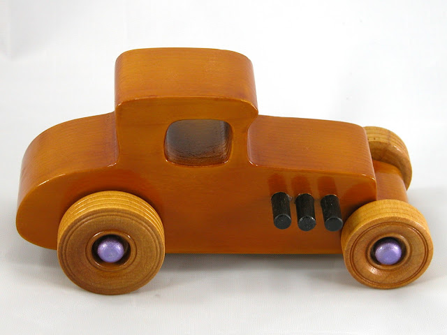 Top Right Side -  Wooden Toy Car - Hot Rod Freaky Ford - 27 Coupe - Pine - Amber Shellac - Metallic Purple Hubs