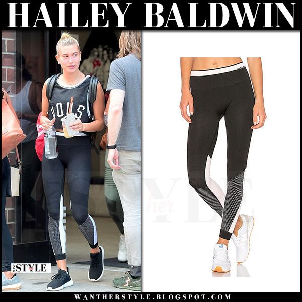 Hailey Baldwin in black tee, black leggings alala and black adidas tubular sneakers leaving the gym what she wore june 14 2017