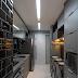 Cozinha estreita e moderna preta e cinza com azulejo metrô e bancada de refeição!
