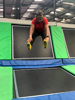 woman in mid air doing a trampoline jump