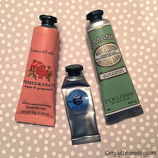 three tubes of  L'Occitane hand cream