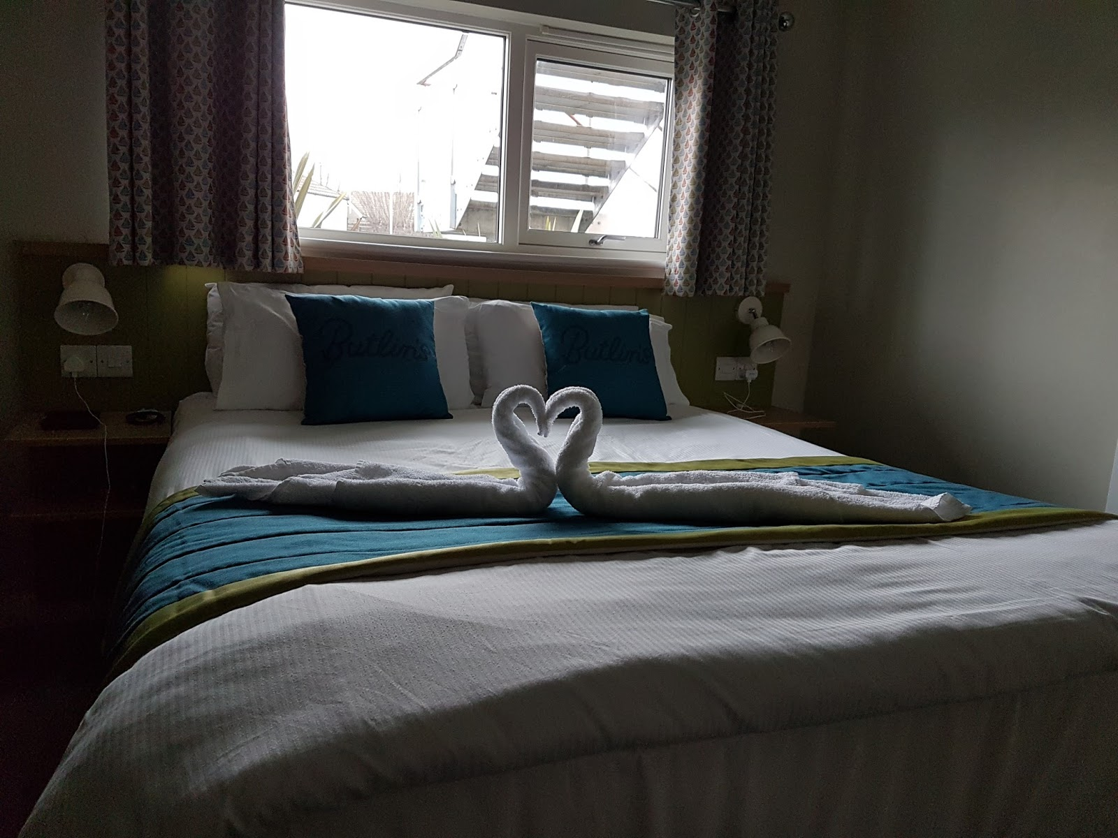 towel swans on bed at butlins minehead  chalet