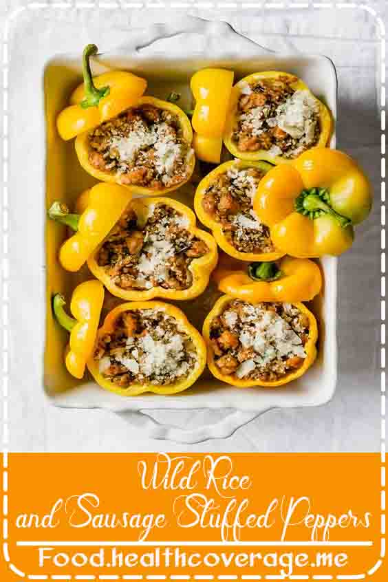 A simple, comforting recipe for Wild Rice and Sausage Stuffed Peppers, with pesto and Parmesan.