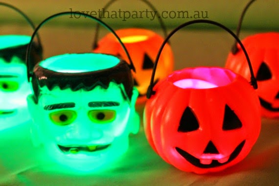 halloween lanterns glowing pumpkin and monster garland and using glow sticks