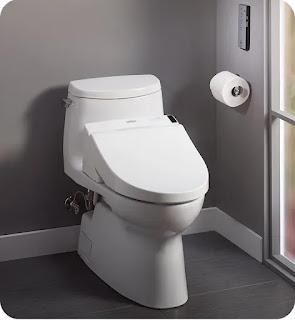 Smart toilet in a gray bathroom.
