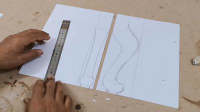 تصميم جانبي و أماي لرجل كرسي على ورقة بيضاء