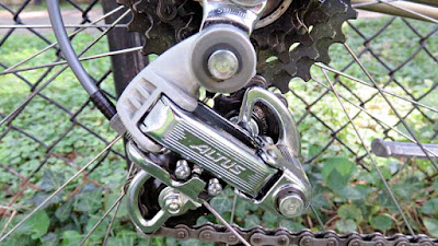 Reara bicycle Derailleur with chain fence backdrop