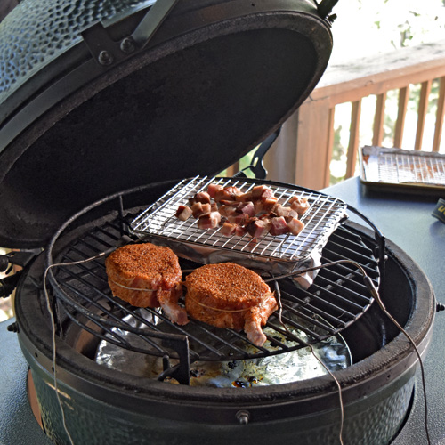 Smoking 2 bone in pork chops and some seasoning bacon on the Big Green Egg.