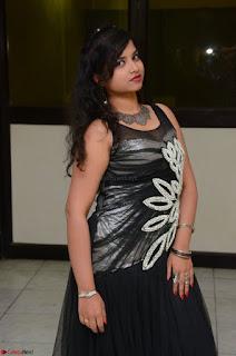 Shrisha Dasari in Sleeveless Short Black Dress At Follow Follow U Audio Launch 061.JPG