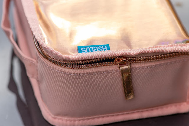 Iridescent rose gold lunch bag close up showing material and zip and SMASH label