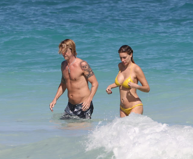 Susan Holms Sexy Pic In Yellow Bikini and Her Husband Duff McKagan