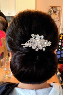 Bride choosing a wedding chignon for the big day