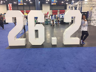 a runner poses for a photo in the marathon expo