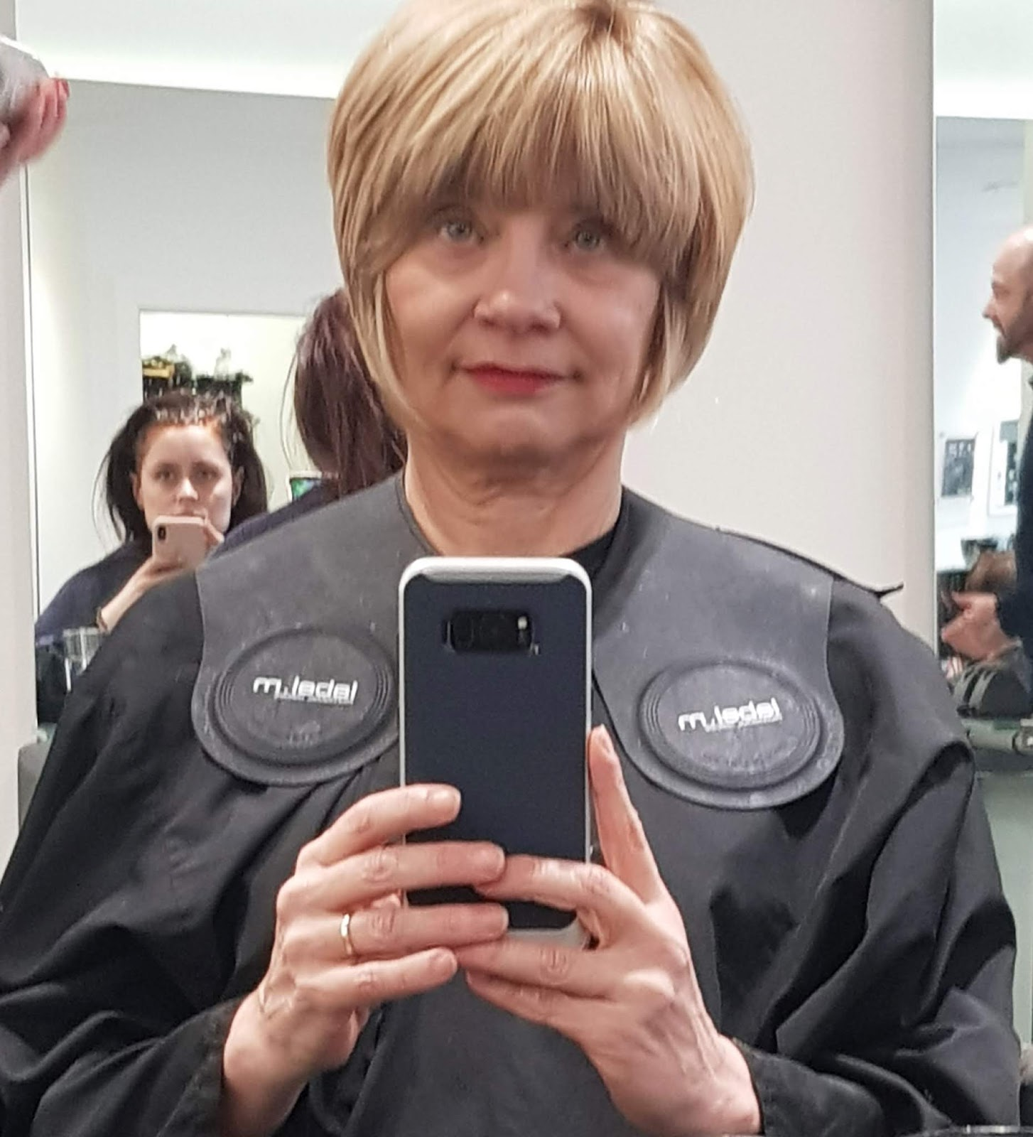"Selfie in a hairdressers salon showing the ""after"" of highlights and a cut"