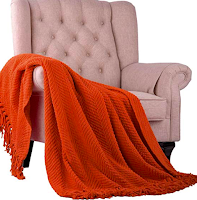 Rust Throw Blanket Draped Over Decorative Chair