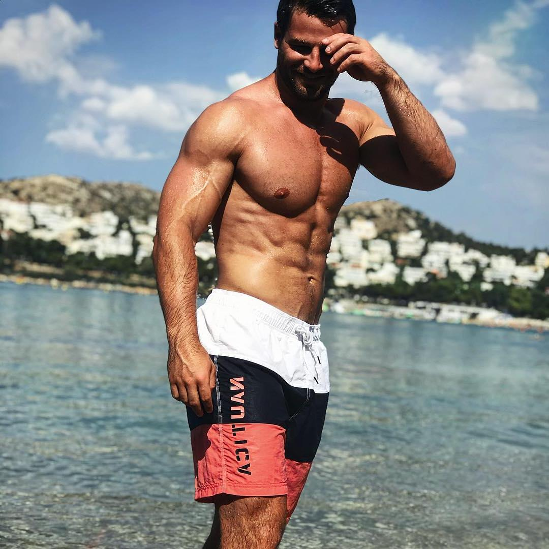 cute-beefy-shirtless-hairy-daddy-smiling-beach