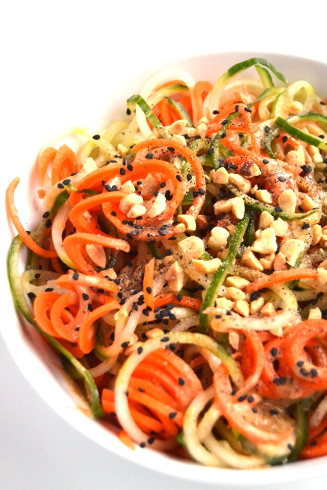 Peanut, Cucumber and Carrot Noodle Salad is ready in just 5 minutes and is the perfect side dish with spiralized vegetables and a tangy peanut sauce topped with sesame seeds and chopped peanuts! www.nutritionistreviews.com
