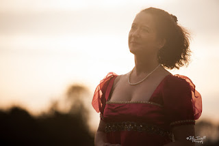 author photo of Maria Grace, standing in sunlight