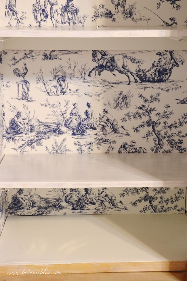 French Country Pantry Makeover with white painted shelves and Seasons Toile Wallpaper