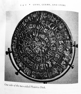 Page 240. One side of the two-sided Phaistos Disk. Jared Diamond. Guns, Germs, and Steel. All tables and figures.