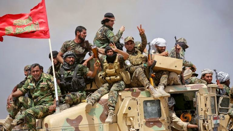 イランはイラクで反撃 - シリア...