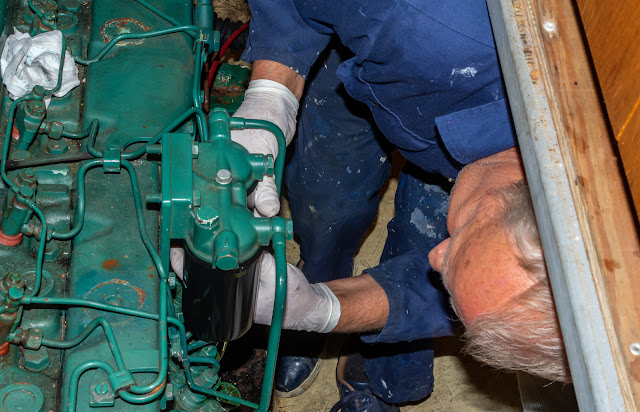 Photo of Phil changing the fuel filters on Ravensdale's port engine