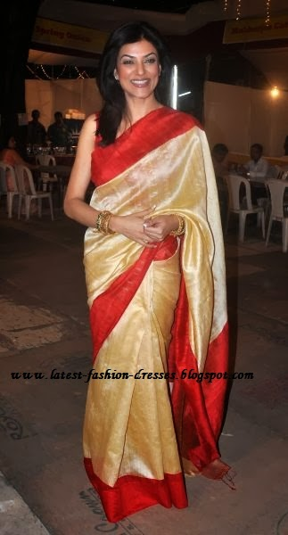 SANDAL WITH RED SILK SAREE IB SUSMITHA SEN
