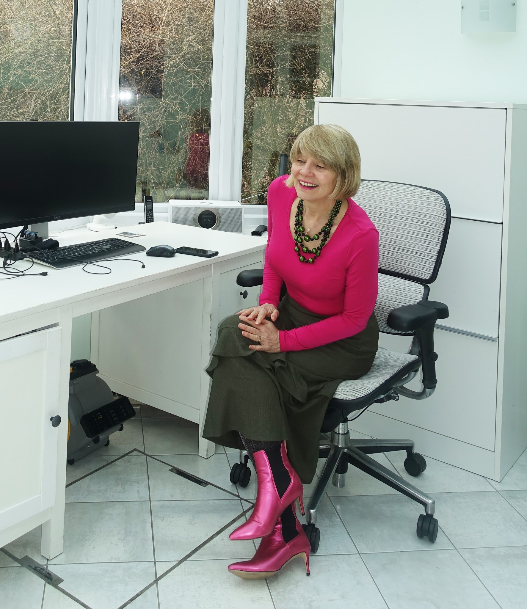 Gail Hanlon from Is This Mutton in khaki tiered skirt and fuchsia pink top and boots