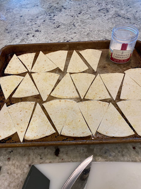 Preparing the tortillas with olive oil spray and sea salt