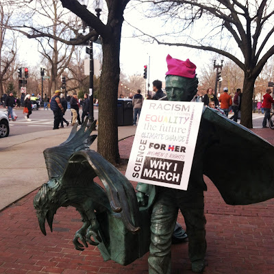 Edgar Allan Poe Statue wearing protest sign and pussy hat at the entrance to the Boston Common for the  Boston Women's March, January 21, 2017
