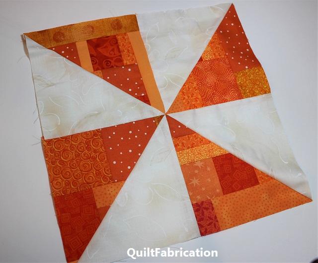 orange scrap pinwheel block