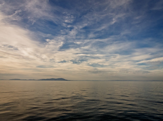 Photo of the Scottish hills across the calm Solway Firth