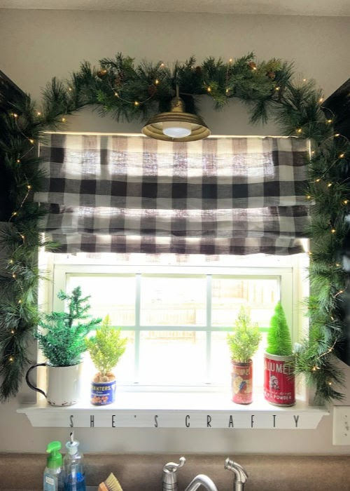 Vintage Christmas Decor Vignettes  |  see various ways to use vintage Christmas pieces in your home decor   |   kitchen, greenery around window