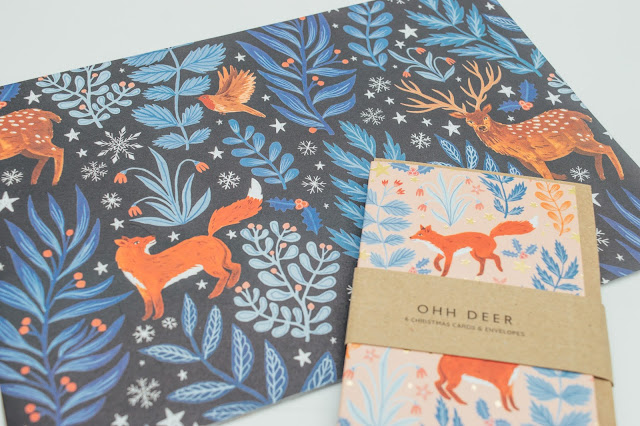 Navy blue wrapping paper with a fox and floral print all over