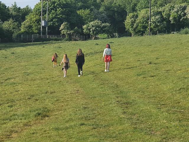 kids-walking-cow-fields