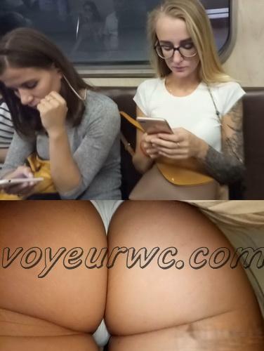 Upskirts 4339-4348 (Secretly taking an upskirt video of beautiful women on escalator)