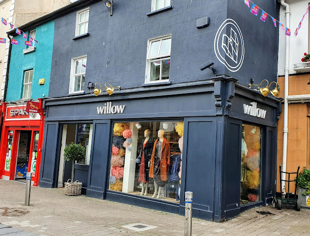 Grey three story shop building in Galway's medieval core