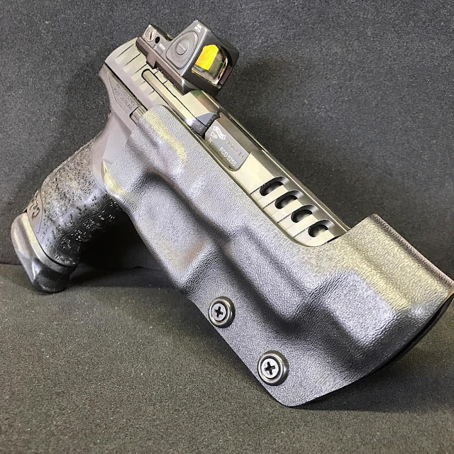 http://www.daraholsters.com/dealer-pricing/custom-race-holster-owb-only/