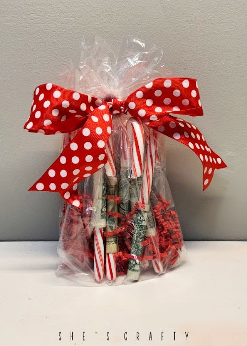 Creative way to give money for Christmas -money wrapped candy canes
