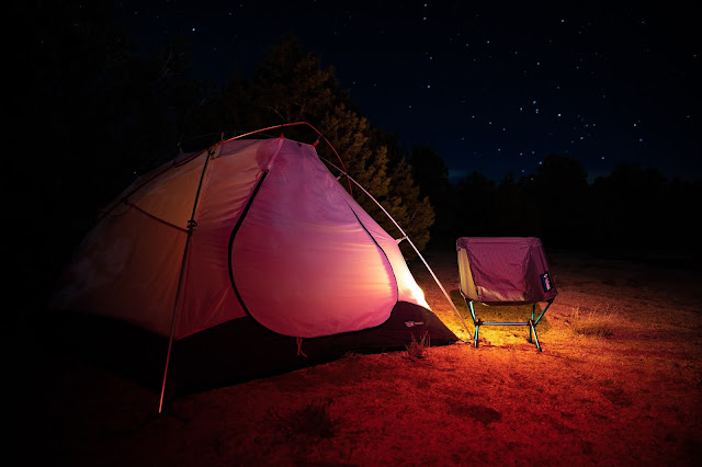 Tent and camping chair Photo by Patrick Hendry on Unsplash