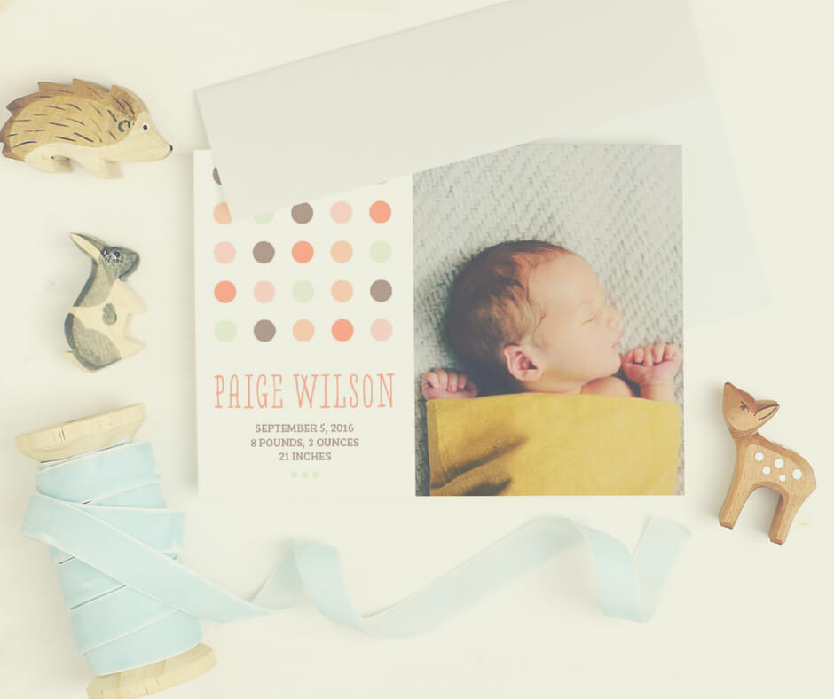 Baby announcements cards with coloured envelopes.