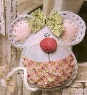 http://www.solountip.com/2012/05/como-hacer-un-raton-alfiletero.html