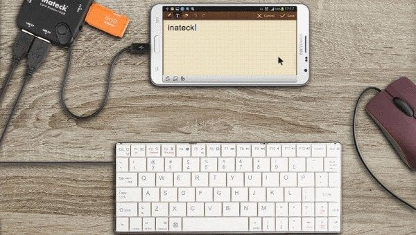 Connect keyboard or Mouse along with your phone