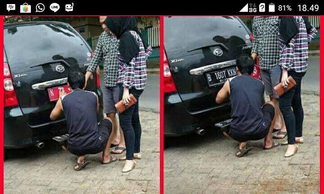 Viral! Foto 2 Orang Sedang Mengganti Plat Mobil Dinas dengan Plat Hitam