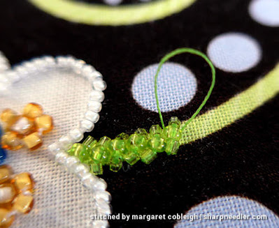 Beginning to embroider the first green tendril. (Wild Child Japanese Bead Embroidery by Mary Alice Sinton)