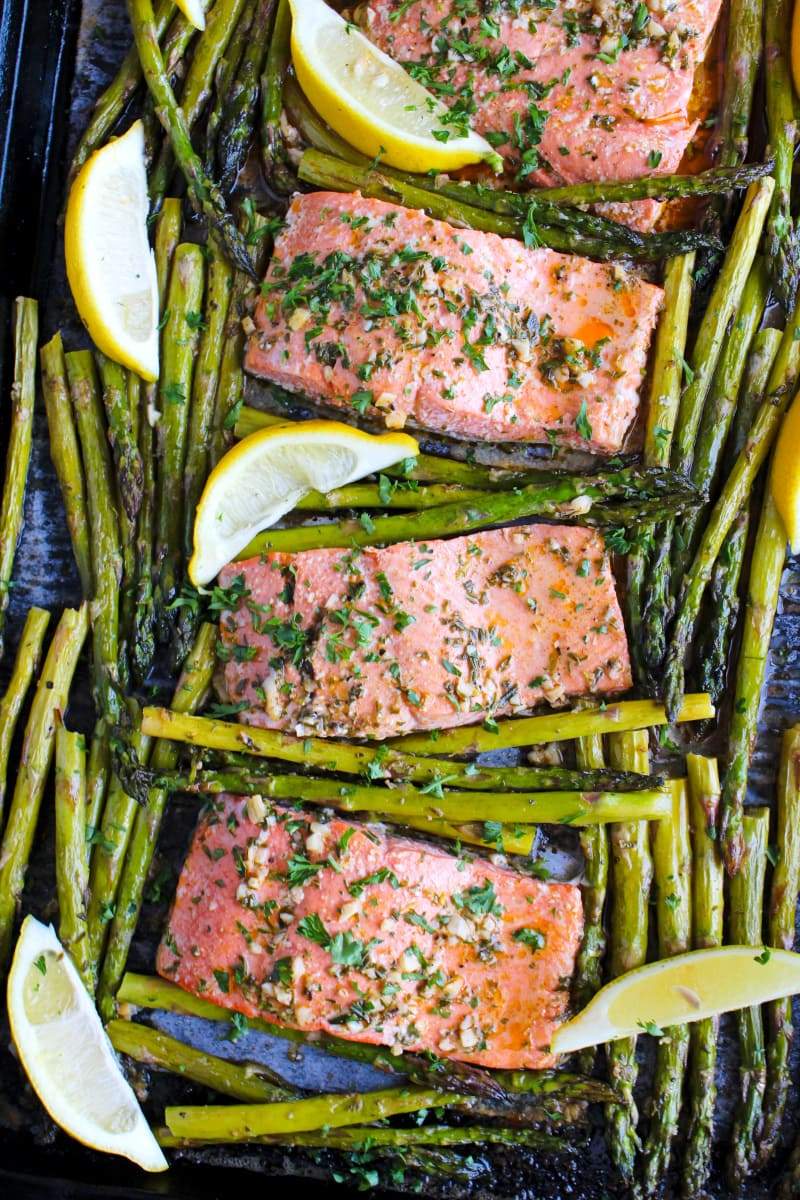 Top view of Lemon Butter Salmon and Asparagus on a sheet pan.