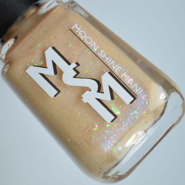 buff creme nail polish with flakies in a bottle